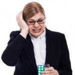 Businesswoman with migraine