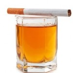 glass of cognac and cigarettes