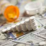Medicine Pills Stacked Like Increasing Graph on Newly Designed U.S. One Hundred Dollar Bills.
