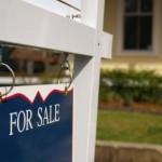 """House for sale with """"For Sale"""" sign"""