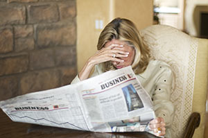 woman-with-newspaper