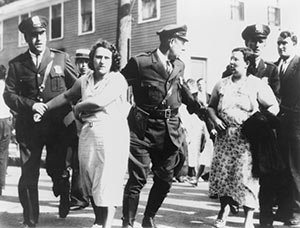 Women textile workers arrested by policemen for picketing the Jackson mill in Nashua, N.H., on Sept. 7, 1934.