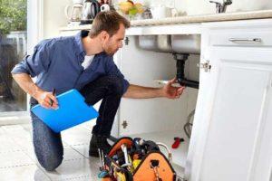man-under-sink-plumber