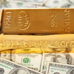 gold bar with on bills