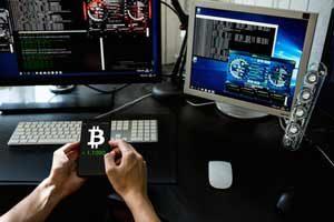 Man holding phone with bitcoin logo