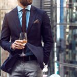 businessman with suit and glass of wine
