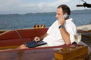 man on boat with lap top